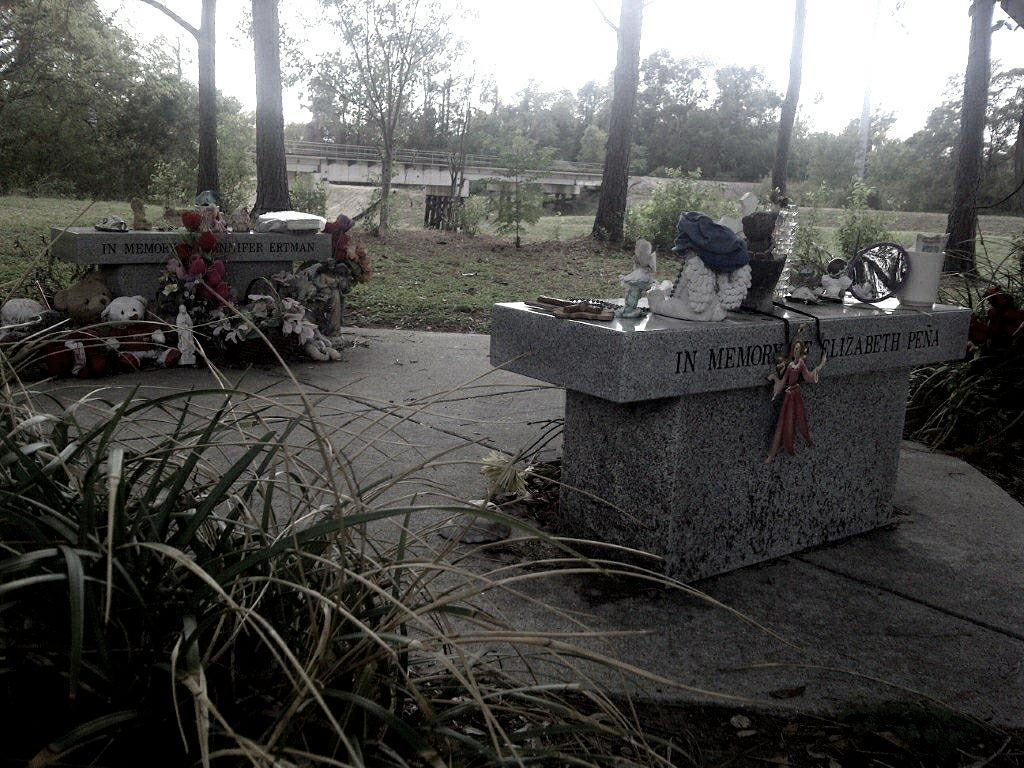 Memorials to Ertman and Pea in TC Jester Park. In the background is the railroad bridge where the two were initially attacked. Photo: Wikipedia Creative Commons/Pepper Hastings