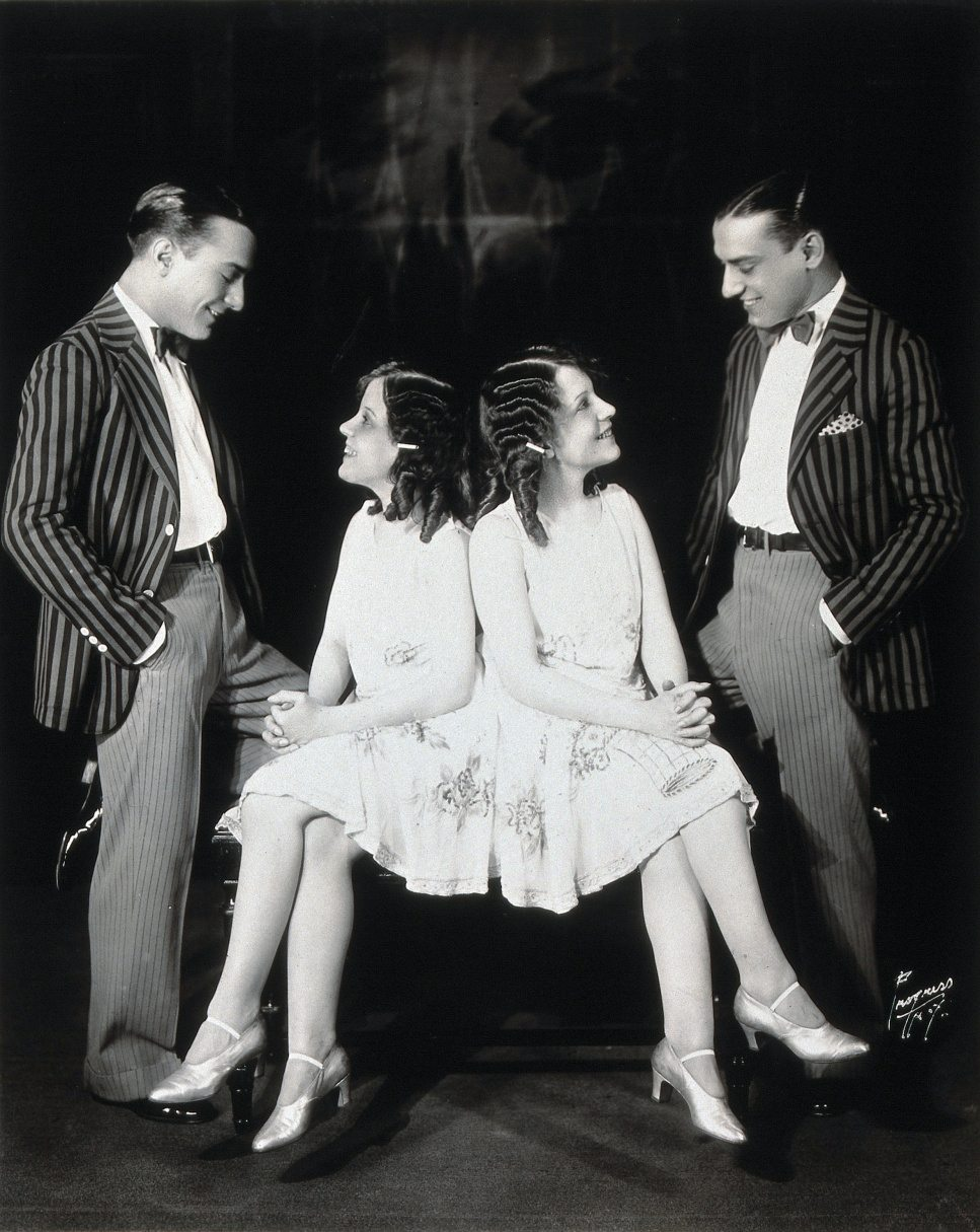 Daisy and Violet Hilton, conjoined twins, being wooed by two young men