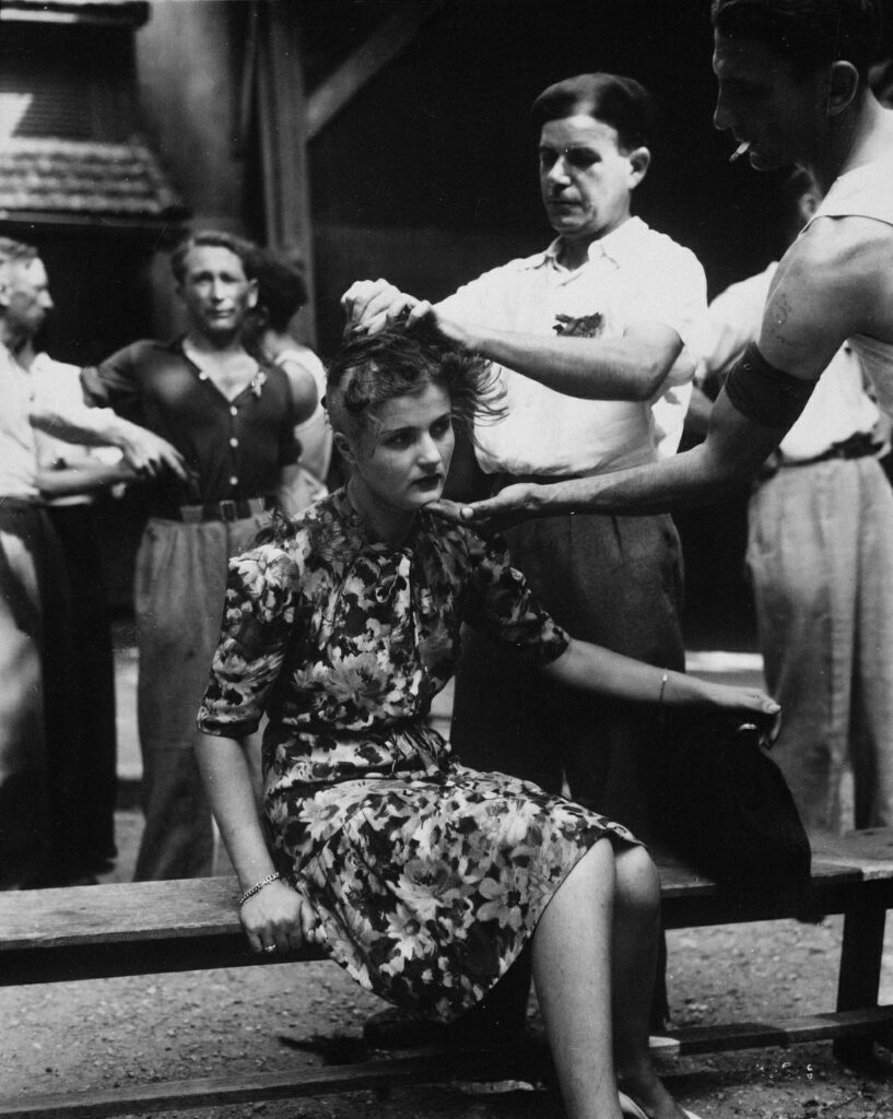 This heartbreaking photo was taken in Montelimar, France, during the ending of World War II, where a French woman has her head shaved by civilians as a penalty for having consorted with German troops. (August 1944)
