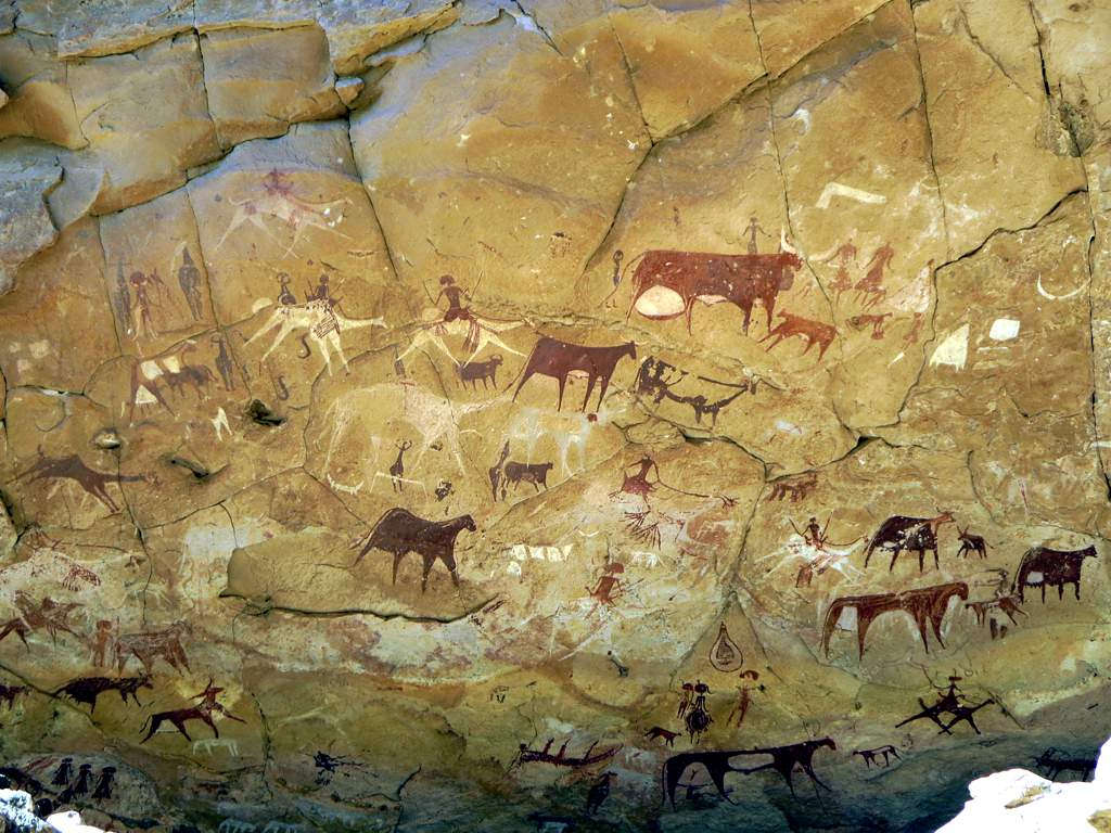 These prehistoric rock paintings are in Manda Guéli Cave in the Ennedi Mountains, Chad, Central Africa. Camels have been painted over earlier images of cattle, perhaps reflecting climatic changes.