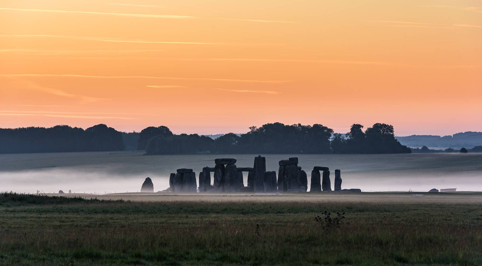 Stonehenge in mist, at Sunrise. The ancient stone monument is located at Salisbury, Wiltshire, England, UK. © Image Credit: Andrei Botnari   Licensed from DreamsTime.com (Editorial/Commercial Use Stock Photo)