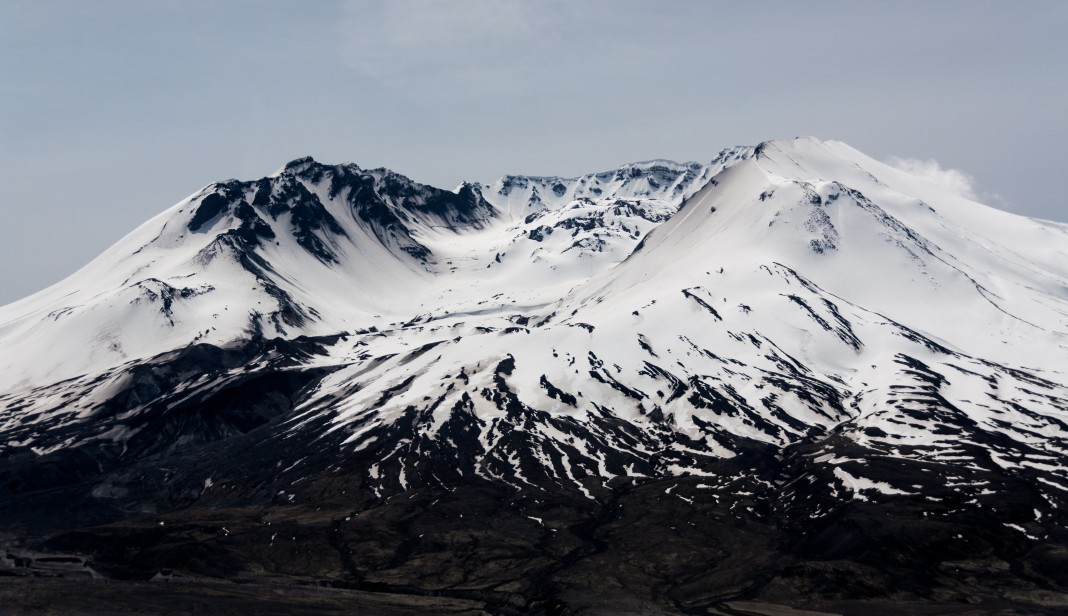 Mt. St. Helen's crater lava dome covered in snow with a dry base. Mount St. Helens is best known for its major eruption on May 18, 1980, the deadliest and most economically destructive volcanic event in U.S. history. Fifty-seven people were killed; 200 homes, 47 bridges, 15 miles of railways, and 185 miles (298 km) of highway were destroyed. A massive debris avalanche, triggered by a magnitude 5.1 earthquake, caused a lateral eruption that reduced the elevation of the mountain's summit from 9,677 ft to 8,363 ft, leaving a 1 mile wide, horseshoe-shaped crater. © Image Credit: Classicstyle | Licensed from DreamsTime.com (Editorial/Commercial Use Stock Photo, ID:108676679)