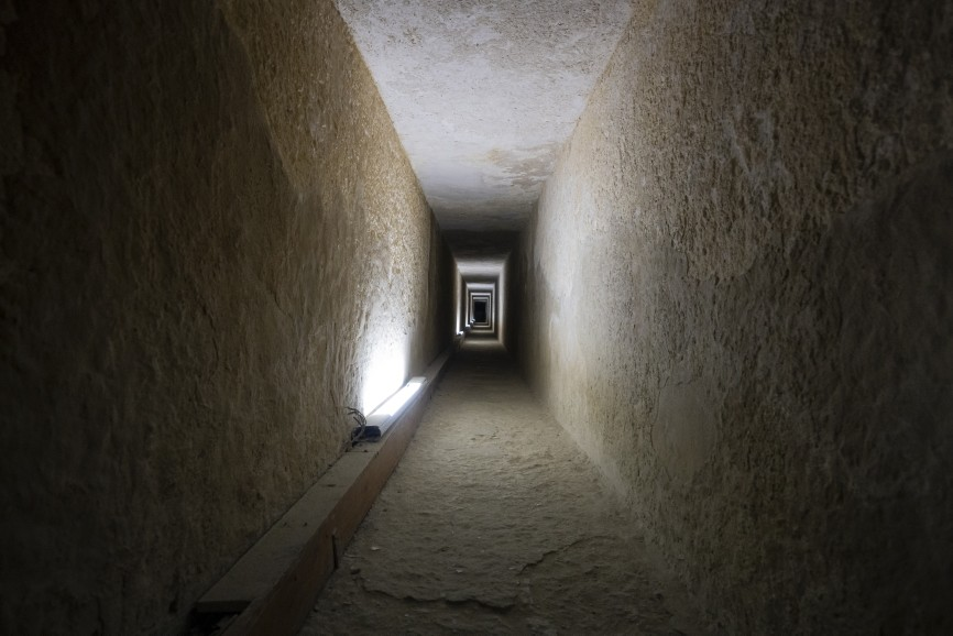 A long passage in the pyramid of Giza, Cairo, Egypt. © Image Credit: Dmitrii Melnikov | Licensed from DreamsTime.com (Editorial Use Stock Photo, ID:221813066)